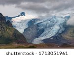 View of Virkisjokull and Falljokull glaciers as seen from route 1, Iceland. These are two of around 30 other outlet glaciers flowing from the ice cap of Vatnajokull, the largest glacier in Iceland
