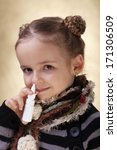 Little girl with nasal spray - fighting cold and the flu - stock photo