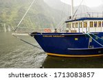 Doubtful Sound, Fiordland, New Zealand - 15 December 2019: 3-masted sailship FIORDLAND NAVIGATOR, operated by REAL JOURNEYS on a rainy day. It's a hotelship for overnight cruises in the Doubtful Sound - stock photo