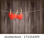 two hearts hanging on a rope in ... | Shutterstock .eps vector #171316355