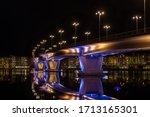 Illuminated Bridge Over Still...