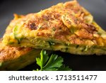 Small photo of Delicious omelette with cheese, courgettes and aromatic herbs