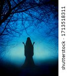 Small photo of Mystical mysterious silhouette young woman girl. Fairytale witch dances magical ritual dance. Beautiful fairy lady prays backdrop amazing foggy haze black trunks enchanted trees, bright blue moonlight