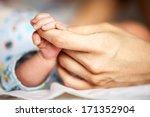 newborn baby holding mother's... | Shutterstock . vector #171352904