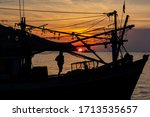 Fishermen On A Boat With Red...