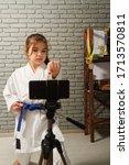 a little girl in a white kimono ... | Shutterstock . vector #1713570811