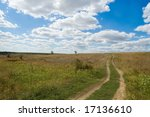 rural dirty road under deep blue sky - stock photo