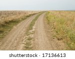 closeup view of rural dusty dirty road in autumn - stock photo