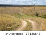 local steppe winding road across ravine - stock photo