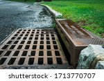 A Storm Drain On The Side Of A...