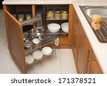 Stock photo detail of open kitchen cabinet with cans of beans 171378521