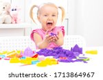 Girl Plays Kinetic Sand In...
