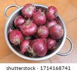 a basket full of onions.