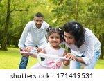 indian family outdoor activity. ...   Shutterstock . vector #171419531