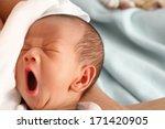 A Baby Boy Yawning