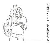 girl with  headphones  mobile... | Shutterstock .eps vector #1714544314