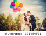 beautiful bride holding bunch... | Shutterstock . vector #171454931