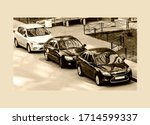Cars In The Courtyard Of A...