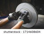 Car mechanic hands installing...