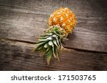 Baby Pineapple On A Wooden...