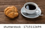 Croissants And Coffee  On Old...