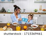 Mom And Daughter Have Breakfast ...