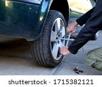 Small photo of car jack has removed the wheel to replace broken after winter summer tires wheel wrench bolts loosen loosen screw check brake pad disc hoses green car garage service