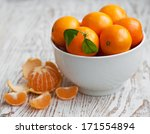 Bowl Of Fresh Tangerines On A...
