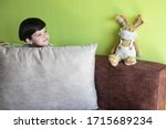 boy at home with bunny in face... | Shutterstock . vector #1715689234