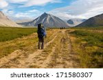 group of hikers moving on wild... | Shutterstock . vector #171580307