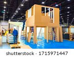 Installation of a plywood frame. Preparation for the construction exhibition. Installation of the layout of the room in the exhibition hall. Advertising of construction and repair services. - stock photo