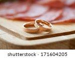 golden rings on wooden tray...   Shutterstock . vector #171604205