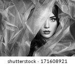 Fashion photo of beautiful women under blue veil. Beauty portrait - stock photo