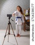 a little girl in a white kimono ...   Shutterstock . vector #1716238177