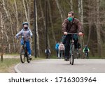 Masked People Ride Bicycles An...