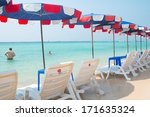 beach chairs and with umbrella... | Shutterstock . vector #171635324