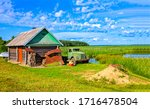 Small photo of Summer village farm scene. Truck in summer village. Village truck view