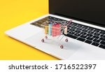 a trolley on top of a laptop...   Shutterstock . vector #1716522397