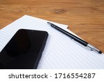phone and sheets close up | Shutterstock . vector #1716554287