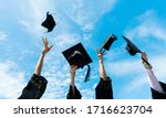 Four Graduates Throwing...