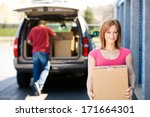storage  woman carrying box to... | Shutterstock . vector #171664301