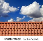 Roof Tiles And Cloudy Sky At...