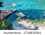 Azure Sea With Rocks And...