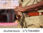 Small photo of Indian policeman close to Police stick and uniform, Indian policeman (CRPF) with bamboo sticks patrols, selective focus, Hand in hand police man view