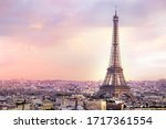 Small photo of Sunset Eiffel tower and Paris city view form Triumph Arc. Eiffel Tower from Champ de Mars, Paris, France. Beautiful Romantic background.