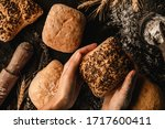 hands holding loaf of bread on... | Shutterstock . vector #1717600411