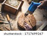 Craftsperson making wooden...