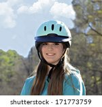 A beautiful young teenage girl ready for a horseback ride. - stock photo