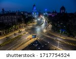 Small photo of MUMBAI/INDIA - MARCH 22, 2020: General view of a deserted road at Chhatrapati Shivaji Maharaj Terminus during the nationwide lockdown as a preventive measure against the COVID-19 coronavirus.