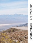 Small photo of Road biker at Father Crowley Point overlooking the vista of desert and mountains.